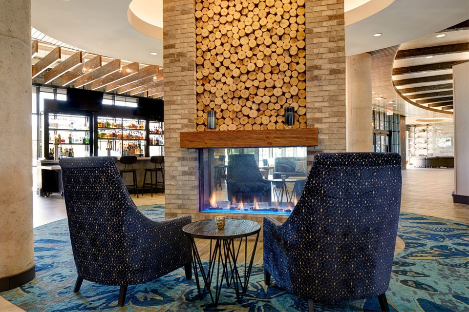 Hotel lobby fireplace with blue chairs