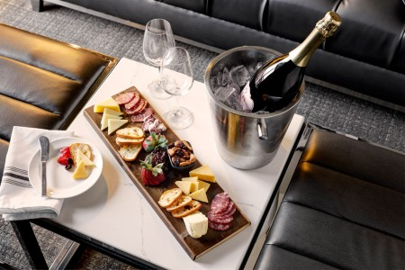 Room service from Archer's Kitchen + Bar — charcuterie board and chilled sparkling wine