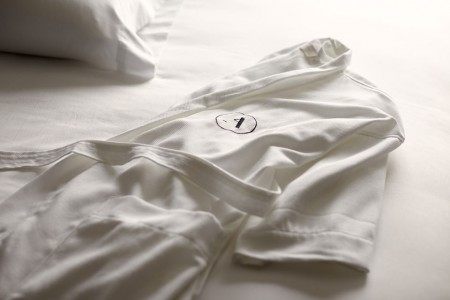 Frette bathrobe on the bed