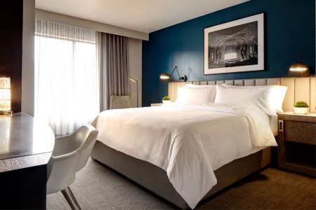 Archer Hotel Florham Park — Classic King Guest Room with bed and local art