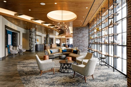 Lobby library with seating and coffee tables