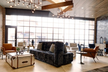 Hotel lobby with soft seating and coffee table