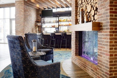 Archer's Kitchen + Bar — Fireplace and blue chairs