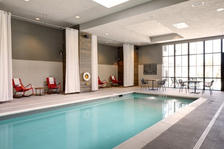 Indoor pool with red rockers