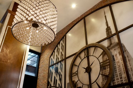 Hotel lobby chandelier and Empire State Building artwork
