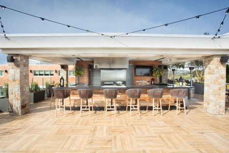 Chef's Show Kitchen bar seating with lights — on the rooftop