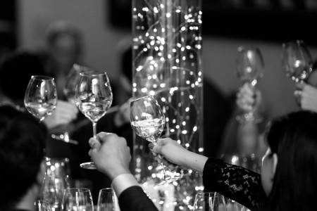 Black and White photo of glasses toasting