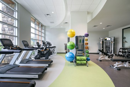 Archer's fitness studio with cardio and lifting equipment