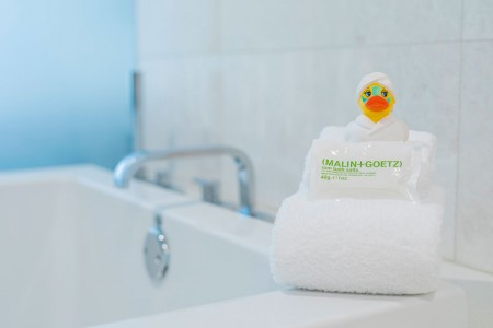 Archer's Den -  rubber duck sitting on edge of soaking tub