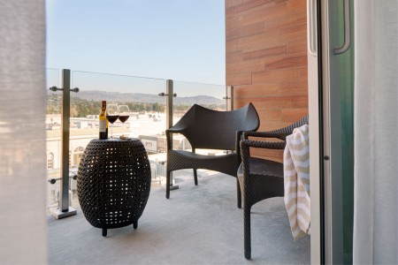 Private alfresco balcony with lounge seating and Napa Valley views