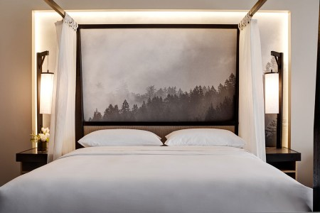 Archer King Balcony Suite - four-poster canopy-draped bed with five-star bedding