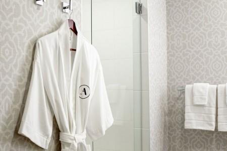Frette robe hanging by walk-in shower