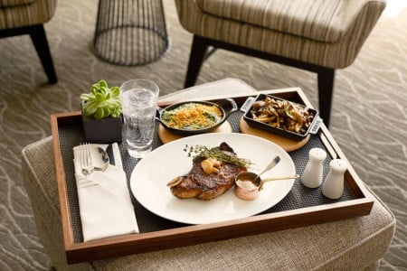 In-room dining from Charlie Palmer Steak - tray with plated food