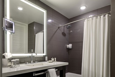 Double Queen - bathroom vanity and mirror with a tub-shower combo