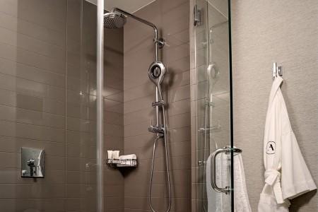 Bathroom walk-in shower and hanging Frette bathrobe