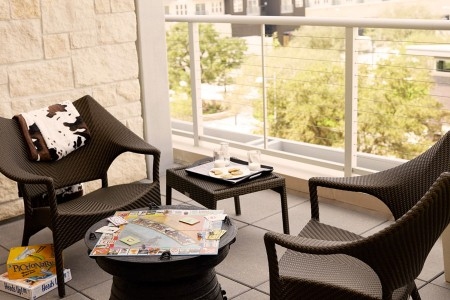 Balcony experience - chairs and tables with board games