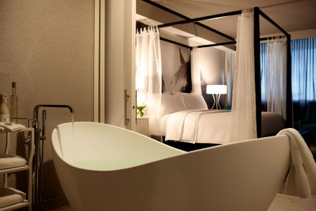 Archer King Suite - modern soaking tub and four-poster bed