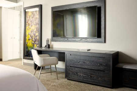 Archer's Den With Balcony + Fireplace - desk and wall-mounted TV in bedroom