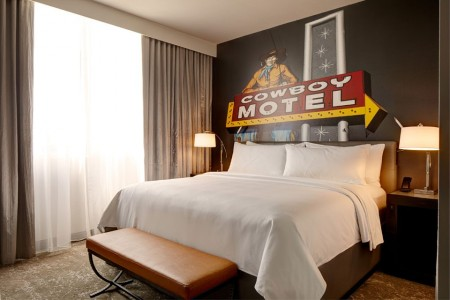 Classic King - bed with five-star bedding and local cowboy motel sign