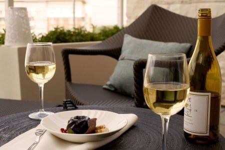 King Balcony Suite - dessert and two glasses of white wine enjoyed on the balcony