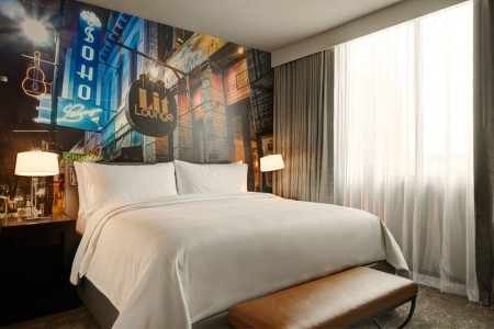 Classic King - bed with five-star bedding and local art of 6th Street