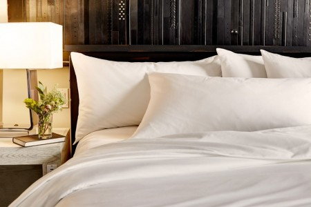 King Balcony Suite - five-star bedding and leather belt wall art