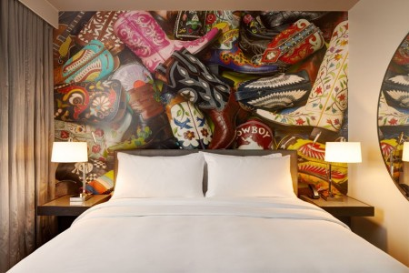 Classic King - bed with five-star bedding and local cowboy boot mural