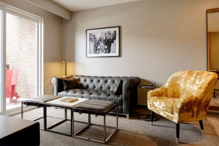Archer's Den - separate living area furnished with a chesterfield-style sofa and side chair