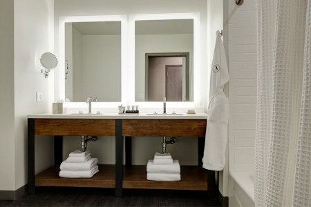 Double King - modern bathroom with a quartz double vanity and mirrors
