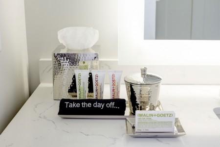 Malin+Goetz luxury bath amenities on bathroom vanity