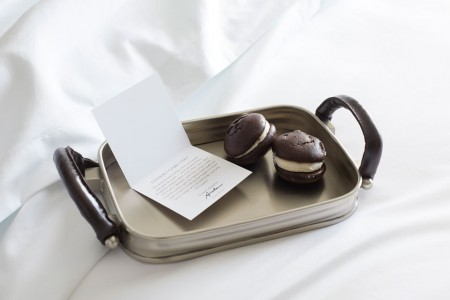 Turndown treat on bed - whoopie pies on a tray with a card
