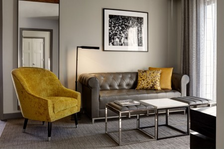 Archer's Den - a chesterfield-style sofa and side chair in the living area