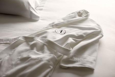 White Frette bathrobe on bed