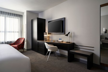 Classic King - oversized desk with welcome amenity and wall-mounted TV