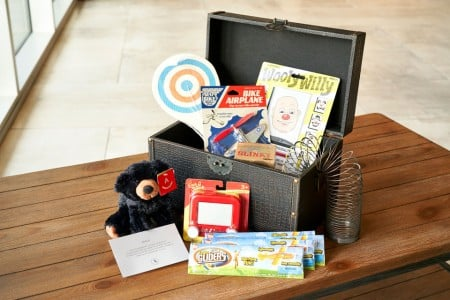 Kid in Archer - a treasure chest filled with toys for young guests
