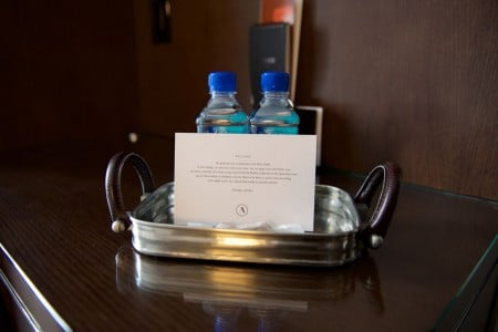 Welcome amenity of complimentary water, salted caramels and card
