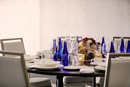 Round table with settings and water bottles