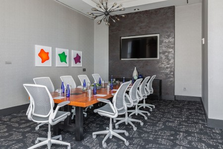 Boardroom with table, chairs and flat-screen TV