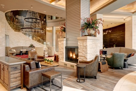 Archer Hotel Austin Lobby with fireplace and seating areas
