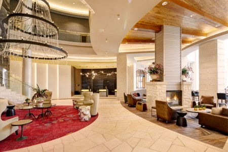 Hotel lobby with front desk and seating areas