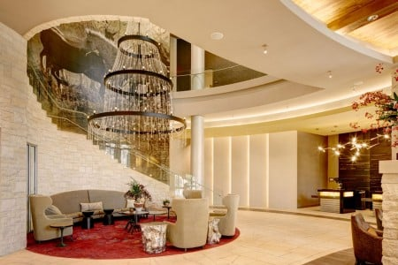 Hotel lobby with chandelier and staircase