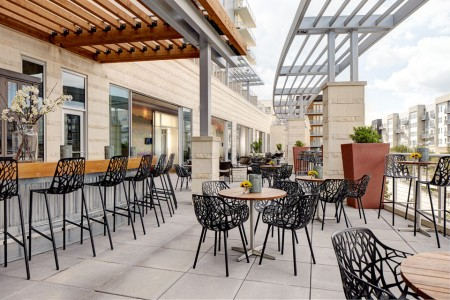 Outdoor patio and bar overlooking Domain NORTHSIDE