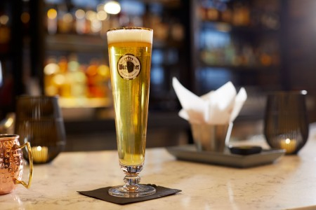 Archer's Kitchen + Bar — Tall glass of beer
