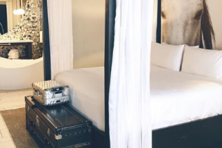 Archer King Suite with four-poster bed and free-standing tub