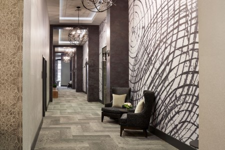 Great Room Foyer — carpeted hallway with seating