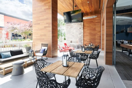 Archer's patio with seating and a flat-screen TV