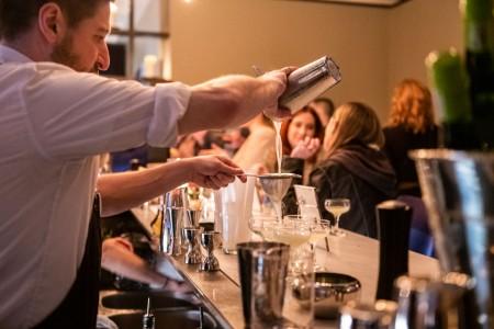 Archer Hotel New York - AVA Social Bartender mixing drinks