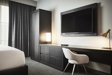 Archer King Suite - work desk with seating and wall-mounted TV