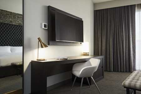 Archer's Den - work desk with white chair and 55-inch flat screen TV