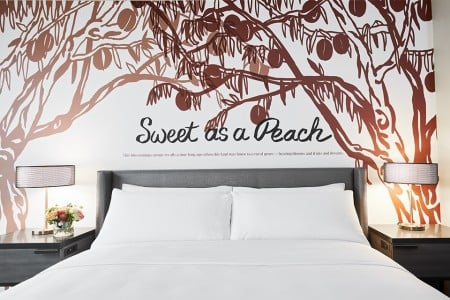 Classic King - bedding detail with 'Sweet as a Peach' mural behind headboard